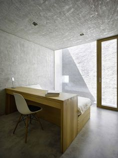 Bedroom inside the New House in Ranzo by Swiss architects Wespi de Meuron.