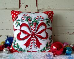 Christmas pillow made from a vintage tablecloth.  Cute!