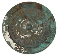 Chinese bronze mirror Han dynasty Circular mirror encircled by scalloped and hatch bands and an outer ring of inscriptions. D: 6 in. Bronze Mirror, Circular Mirror, Chinese Antiques, Archaeology, Mirrors, Auction, Objects, China, Bands
