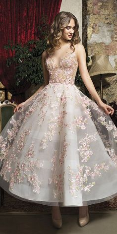 21 Incredible Tea Length Wedding Dresses is part of Wedding dress guide - Tea length wedding dresses are invented for small and sassy brides who want a sexy look These style of dresses will underline your features, make you Wedding Dress Tea Length, Tea Length Dresses, Floral Dress Wedding, Floral Ball Dresses, Colorful Wedding Dresses, Floral Gown, Floral Lace, Trendy Dresses, Cute Dresses