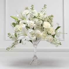 white roses, carnations, lilies