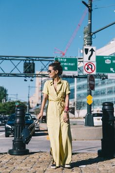 184f54db7d3 Sara Escudero is a vision of summer beauty in this bright yellow maxi shirt  dress from