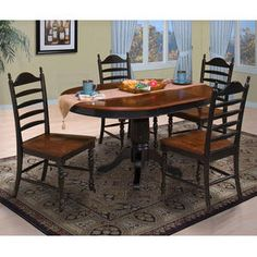 A cherry and black painted dining set with a cottage design is very popular right now.