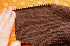 Knit Backwards: A Tutorial.  I've taught myself how to do this so I can knit the 10-stitch afghan.
