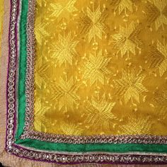 Phulkari Yellow Dupatta with multicoloured border - Traditional Punjabi Phulkari Dupatta with Green-Magenta-gold border. This can be teamed up with Green / Magenta Salwar Suit or Lehenga