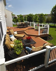 Spacious TimberTech deck with RadianceRail in White with Earthwood Evolutions Decking