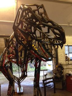 The right side of the head with the bits added - looking pretty fierce now - Tyrannosaurus Rex Sculpture by Hubcap Creatures
