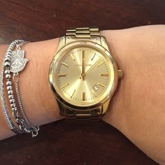 Michael Kors 'Runway' watch in gold Michael Kors 'Runway' gold watch with date adjust. Still have original box, links, and instruction book! MICHAEL Michael Kors Jewelry
