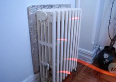 DIY reflective insulation! Save money on heating! Why didn't I think of this?     Wrap a piece of cardboard with some tin foil and place it behind radiator with shiny side facing out. This prevents the wall from absorbing heat, and reflects the heat back into the room