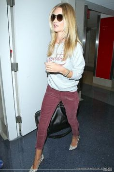 Rosie Huntington-Whiteley.. Etoile Isabel Marant Revolution sweater, Paige Jane jeans, Isabel Marant Pumps, and Balenciaga Voyage 24h bag..