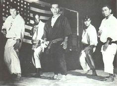 WILLIAM KWAI SUN CHOW- (July 3, 1914–September 21, 1987, AKA William Ah Sun Chow Hoon) was instrumental in the development of the martial arts in the United States, specifically the family of styles referred to as kenpo/kempo- Most notably Edmund K. Parker's style of American Kenpo.  Parker (far left) is pictured here with Chow (center).