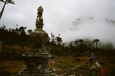 """Stupa by shores of Lake Danakosha where Padmasambhava appeared miraculously in the blossom of a lotus in the lake called """"Ocean of Milk"""" in South West Odiyana, which is also known as Lake Danakosha located on the Afghanistan-Pakistan frontier"""