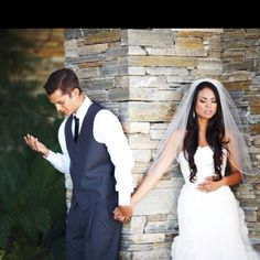 Couple praying before wedding, while someone takes a picture. This is the most adorable, wonderful thing :')