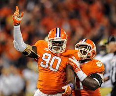 Clemson defensive end Shaq Lawson (90) celebrates a first-quarter sack with Grady Jarrett. (Richard Shiro/AP)