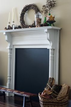 Fake fireplace with chalkboard.