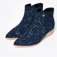 Astrological dreams. Navy suede ankle bootie. Silver and crystal embellished constellations. Pointed toe. Wooden block heel. - 2 inch heel - UPPER: 100% Cow Suede - LINING: Pigskin, Microfiber - OUTSO