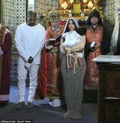 Incredible moment: Kim Kardashian and Kanye West took their daughter North to be baptised ...