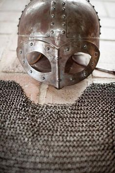 Copy of a helmet and chain mail from the warrior's grave at Gjermundbu in Norway