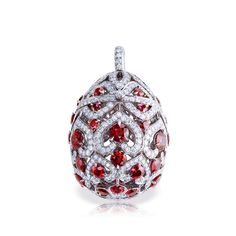 FABERGE, the ZénaÏde egg locket in white gold with white diamonds and rubies.