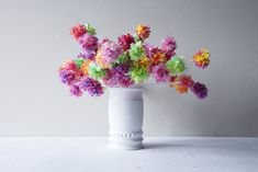 Tutorial: easy pom pom flowers made from cheap plastic leis from Party City!