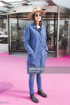 Rosa Copado wears Vintage shoes, Diesel Jeans, Mango Jacket, Mango Jersey, Vintage Sunglasses and La Doa hat during Mercedes Benz Fashion Week at Ifema on February 19, 2016 in Madrid, Spain.