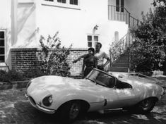 Steve McQueen with his wife Neile at their Laurel Canyon home admiring his 1957 XK-SS 1978 Gene Trindl - Image Steve Mcqueen Cars, Laurel Canyon, Couples Images, Jaguar, Photos, Black And White, Mc Queen, Ss, King