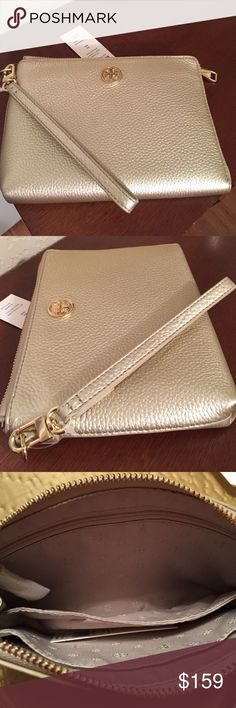 """Tory Burch """"Landon"""" Gold Leather Wristlet. NWT. Large enough to hold an iPhone 6 in a separate inside compartment and large enough to hold an iPhone 6 Plus in the main compartment. There is plenty of room for a small wallet, lipstick, etc. The Pebbled leather color is """"soft gold"""" and it's very pretty. Wristlet strap is detachable and all hardware is in gold. It's the perfect size and classy too. Approximate measurements: 7.5"""" L x 6"""" H. New, never used, with tag. Tory Burch Bags Clutches…"""