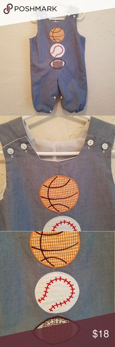 """Vintage Chambray Sports Romper 🏀⚾🏈 Size 18-24M Perfect for sporting events. Features a basketball, baseball, and football. Looks great worn alone or with a long or short sleeved onesie for added warmth. Buttons at either the top or with 5 buttons at the crotch. Lined. Tagged size 24 months, but I'm listing it 18-24 months because that seems more accurate.  Total length: 22.5"""" Waist: 12.75"""" In excellent used condition.  Bundle and save. No trades please. Vintage Bottoms Jumpsuits & Rompers"""