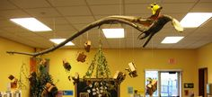 simple and nice. natural materials hanging in/around the classroom.