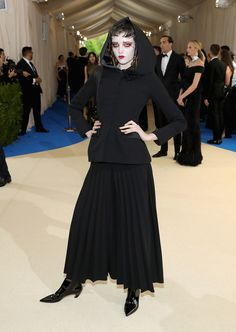 Model Grace Hartzel turned up looking like a red carpet witch in Olivier Theyskens--in the best possible way! She's wildly chic in a black hooded jacket and pleated skirt. Her makeup might have been lifted from the Fall 1997 Comme des Garçons show look.