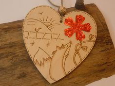 Personalised wooden heart with flower-gazing fox by ShinyCraftwork