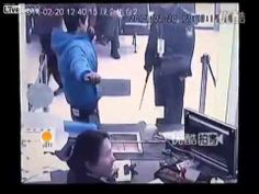 Caught on camera: Bank teller LAUGHS in the face of would-be bandit who ...