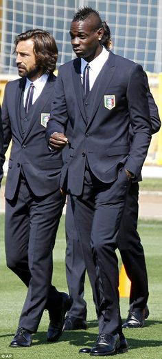 Looking sharp: Mario Balotelli (right) stands alongside Andrea Pirlo in a suit preparing f...