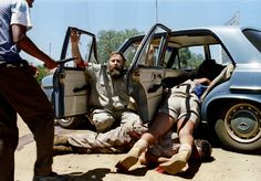 A member of the South Africa's neo-Nazi Afrikaner Resistance Movement (AWB) begs for his life moments before being shot dead by a soldier in the centre of the embattled Boputhatswana capital in 1994. Photograph: Kevin Carter/Reuters