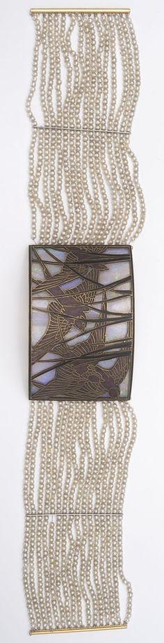 An Art Nouveau gold, enamel, opal and pearl 'Swallows in Reeds' chocker, by René Lalique, Paris, circa 1900. Signed Lalique. #Lalique #ArtNouveau #choker