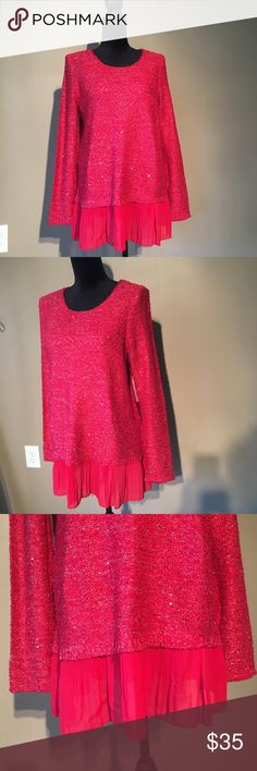 NWT ALFANI Red Sweater with Ruffle hem sz M This is so cute and would be great for the holidays!!  NWT ALFANI Bling bling sweater with a ruffle around the bottom.  This sweater is red and has silver glitter thread running through it,, and little red sequences all over.  Can you say ADORABLE!!  NON Smoking chest 38 length 27 inches including the ruffle. This would be a great gift for you or someone else Alfani Sweaters Crew & Scoop Necks