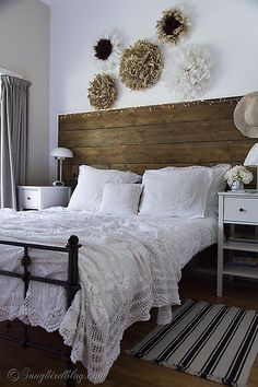 I am loving my white vintage crochet blanket on my bed. The crochet pattern with roses adds so much texture to my white bedding. She's the s...