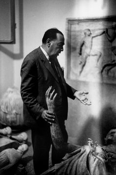 Henri Cartier-Bresson. Greek archaeologist Ioannis Papadimitriou in front of a bronze statue of Minerva that he discovered in Pireas in 1958