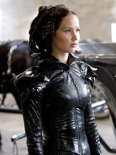 """Although Katniss stayed true to her braid for most of the film, as the """"Girl on Fire"""" during the parade of tributes, she had some serious helmut hair, in a good way. """"For the chariot ride, I made a helmut out of hair so that it looks like an almost Gladiator-like headpiece,"""" Flowers notes of the headdress of assorted braids, including French braids, basket weaving, and plaiting. """"There were 10 different braids in there."""""""
