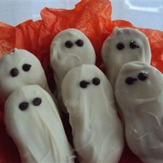 "Halloween Ghosties | ""Peanut butter sandwich cookies are dipped in white chocolate and given two little ghostly eyes made out of chocolate chips."""
