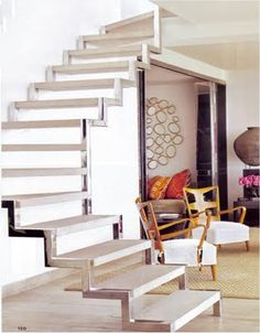 a simple open stair with a polished metal edge