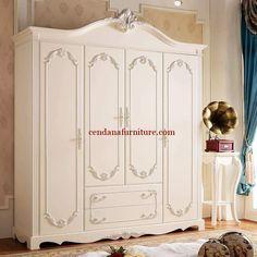 Almari Pakaian 4 Pintu Putih Lady memiliki tampilan cantik dengan design semi minimalis terbuat dari kayu jati/mahoni dengan finishing duco putih.