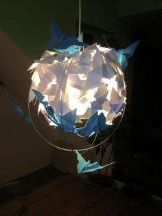 Origami chandelier. Made from paper and wire. Info: http://handmade-decorating.wix.com/hand