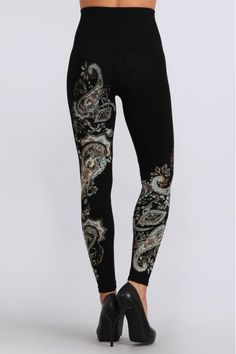 One-size high waisted legging with a paisley print. These adorable leggings can be worn with an oversized sweater and heels or add our sports bra and hit the gym.  High Waisted Legging by M. Rena. Clothing - Bottoms New York