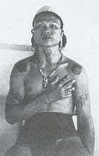 A Kenyah man tattooed in the custom of the Ibans