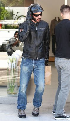 Actor Keanu Reeves sports his Harley Davidson jacket while running errands on his motorcycle in West Hollywood, CA on September 26th, 2012. Keanu's big budget comeback movie 'Ronin 47' has been delayed to due a balloning budget of over $225 million! (September 26, 2012 - Source: FameFlynet Pictures)