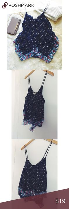 Abercrombie + Fitch Polka Dot Floral Tank Cute and full of personality! Adorable polka dot print with a floral hemline. Adjustable straps and swingy cut. Gently used. Great condition. Abercrombie & Fitch Tops Tank Tops