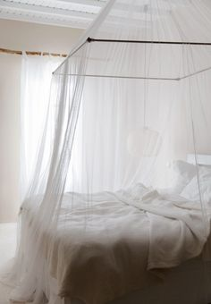 All white bedroom with draping