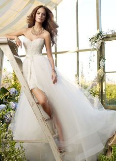 Lace mini dress/wedding gown by Tara Keely. Take the long tulle skirt off for the reception.