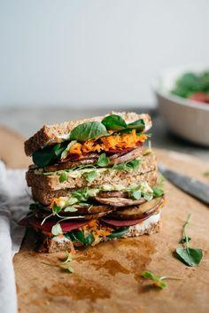 {Avocado club sandwich with marinated portobello mushrooms.}